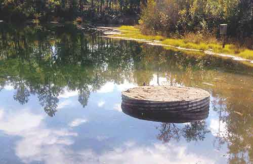 Corrugated-metal-pipe-for-use-in-pond-and-dam